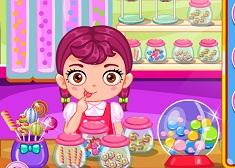 Bebelusa la Magazinul de Dulciuri